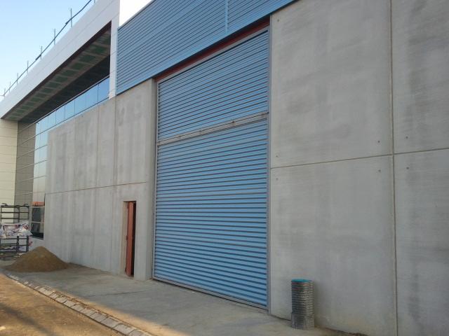 Puertas industriales y para vallas productos hermanos for Puertas industriales